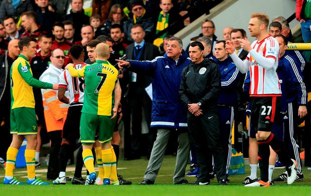 Norwich and Sunderland players confront one another including manager Sam Allardyce of Sunderland after Robbie Brady's tackle on DeAndre Yedlin