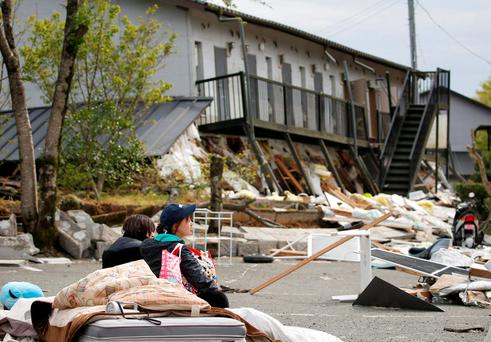 A collapsed apartment caused by earthquakes in Minamiaso town, Kumamoto prefecture, southern Japan, in this photo taken by Kyodo April 16, 2016. Reuters/Kyodo