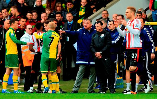 Norwich and Sunderland players confront one another including manager Sam Allardyce of Sunderland after Robbie Brady's tackle on DeAndre Yedlin during the Barclays Premier League match between Norwich City and Sunderland at Carrow Road