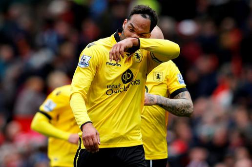 Aston Villa's Joleon Lescott looks dejected at the end of the match after being relegated from the Premier League