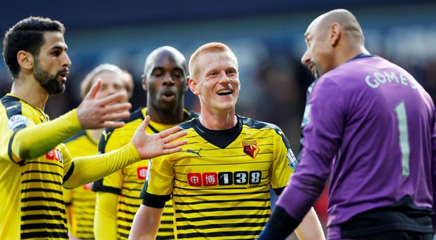 Watford's Heurelho Gomes celebrates after the game with Ben Watson and Miguel Britos Reuters / Eddie Keogh