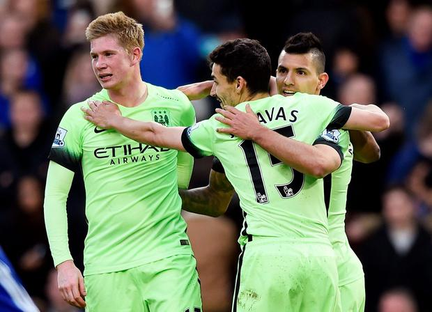 Sergio Aguero celebrates with team mates after scoring the third goal for Manchester City and completing his hat trick Reuters / Dylan Martinez