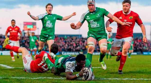 Niyi Adeolokun, Connacht, goes over to score his side's third try despite the tackle of Darren Sweetnam, Munster. Guinness PRO12 Round 20, Connacht v Munster. The Sportsground, Galway. Picture credit: Stephen McCarthy / SPORTSFILE