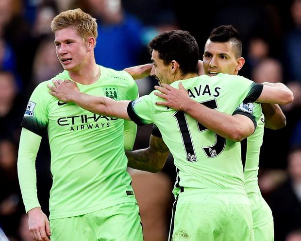 Sergio Aguero celebrates with team mates after scoring the third goal for Manchester City and completing his hat trick. Photo: Dylan Martinez/Reuters