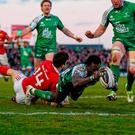 Niyi Adeolokun touches down for Connacht's third try despite the tackle of Darren Sweetnam. Photo: Stephen McCarthy / Sportsfile