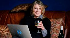 Carol Hunt enjoys a drink at home. Photo: Steve Humphreys