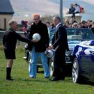 THROW-IN: Chris Evans and Matt LeBlanc with local referee Richie Williams filming Top Gear at Gallarus GAA club, Kerry. Photo: Don MacMonagle