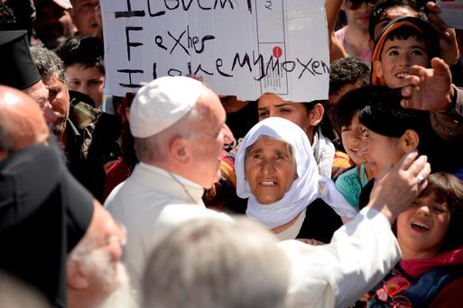Pope Francis greets migrants and refugees at Moria refugee camp Photo: REUTERS/Filippo Monteforte/Pool