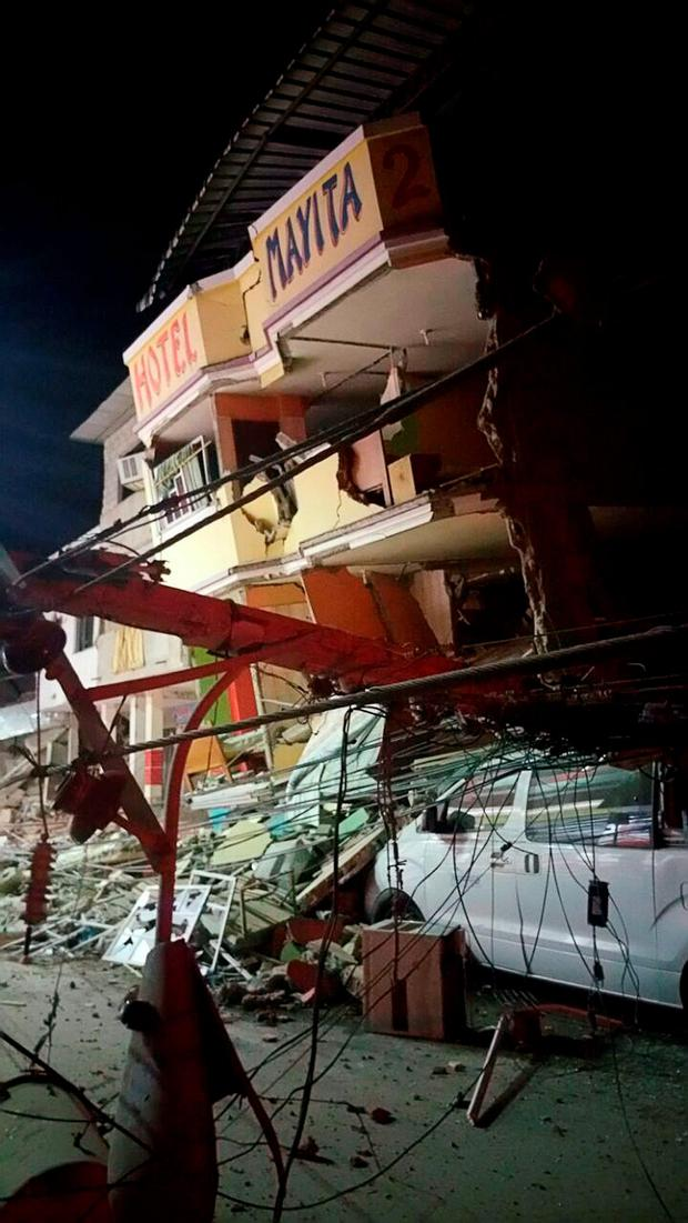A collapsed hotel is seen after a 7.8 magnitude earthquake struck off the country's northwest Pacific coast causing