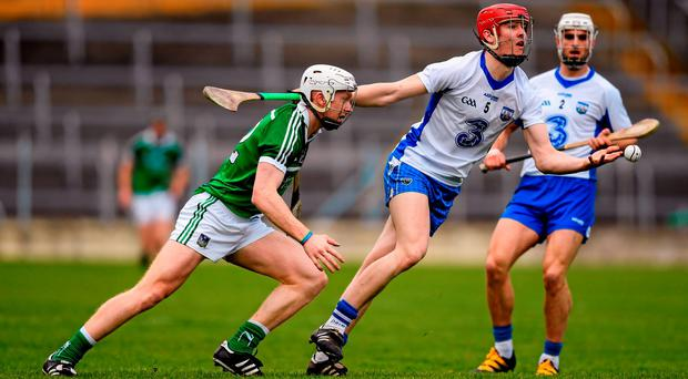 Tadhg de Burca, Waterford, in action against Cian Lynch, Limerick