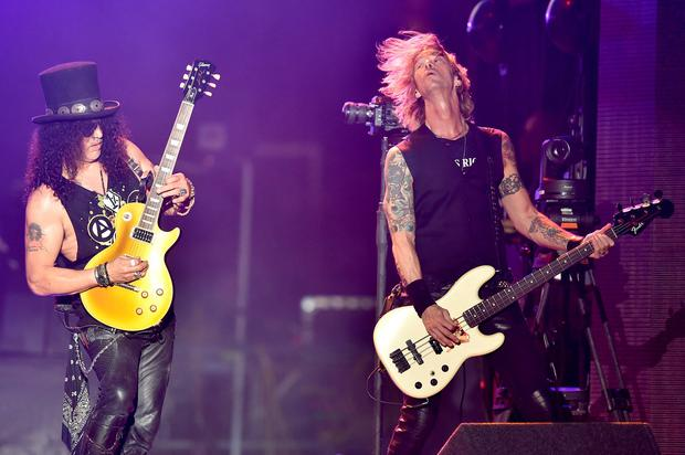 Musicians Slash (L) and Duff McKagan of Guns N' Roses perform onstage during day 2 of the 2016 Coachella Valley Music & Arts Festival Weekend 1 at the Empire Polo Club on April 16, 2016 in Indio, California. (Photo by Kevin Winter/Getty Images for Coachella)