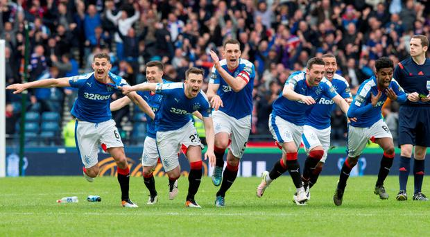 Rangers celebrate winning the penalty shoot out during the William Hill Scottish Cup semi-final match at Hampden Park