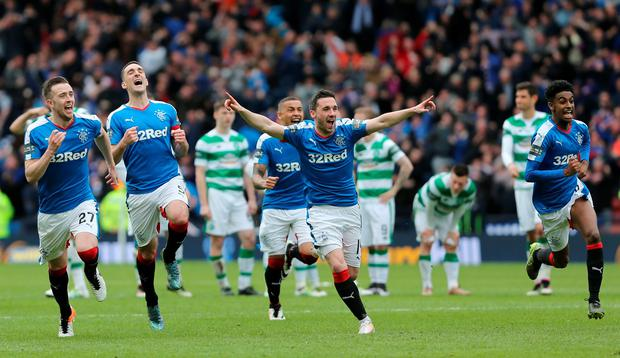 Rangers players celebrate after winning the penalty shootout