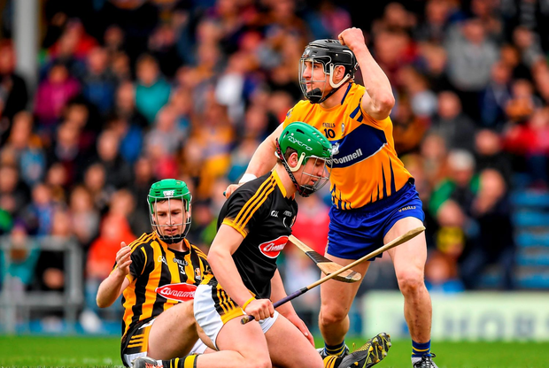 John Conlon, Clare, celebrates after scoring his side's first goal past Kilkenny goalkeeper Eoin Murphy and Joey Holden