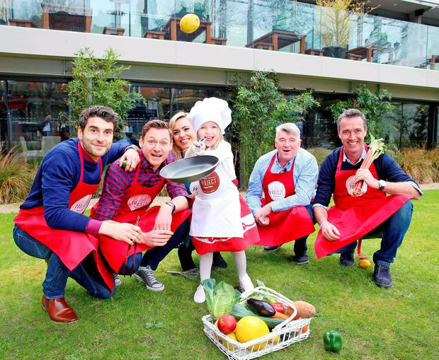 Juneau Conroy, one of Ireland's youngest chefs, celebrates Getting Ireland Cooking alongside celebrity ambassadors Bernard Brogan, David Gillick, Anna Geary, Martin Shanahan and Kevin Dundon. Photo: Marc O'Sullivan