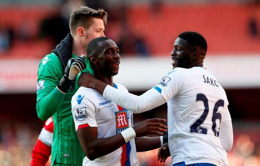 Crystal Palace's Yannick Bolasie celebrates with Bakary Sako and Wayne Hennessey after the game