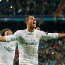 Real Madrid's Cristiano Ronaldo celebrates scoring his side's third goal against Wolfsburg