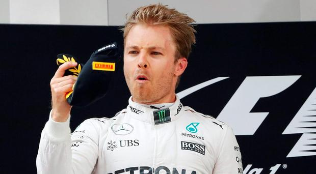 Nico Rosberg celebrates on the podium after winning the Formula One Chinese Grand Prix in Shanghai. Photo: Aly Song/Reuters