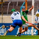 Waterford's Tom Devine shoots to score his side's third goal in their Allianz NHL semi-final victory against Limerick. Photo: Stephen McCarthy / Sportsfile