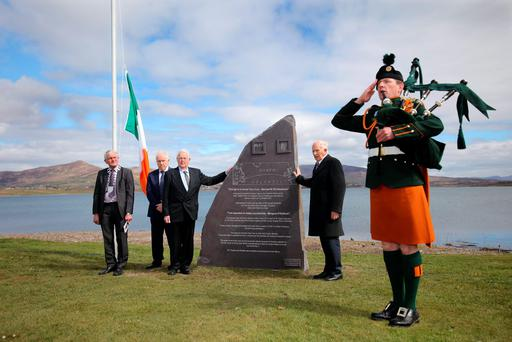 Austin and Diarmuid Ring unveil the commemorative stone at the cable station on Valentia Island, Kerry, honouring Timothy and Eugene Ring and Rosalie Rice. Photo: Valarie O'Sullivan