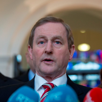 Acting Taoiseach Enda Kenny eyeing 'political outsider. Photo: Arthur Carron