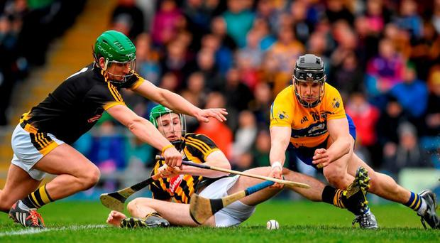 Clare's John Conlon pounces to score his side's first goal past Kilkenny goalkeeper Eoin Murphy and Joey Holden. Photo: Stephen McCarthy / Sportsfile