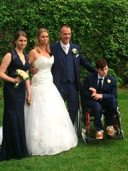 Ger Corcoran pictured on her wedding day with new husband John, daughter Halle (13) and son Dylan (16). Dylan has multiple disabilities and Ger is his full-time carer. Photo: Ciara Wilkinson