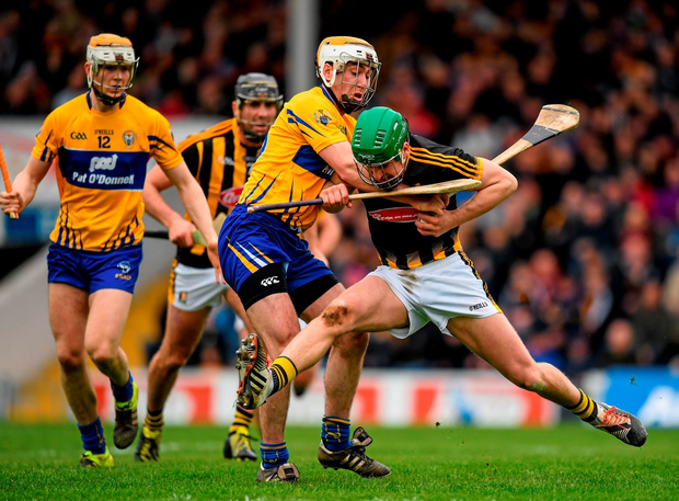 Kilkenny's Eoin Murphy, is challenged by Clare's Podge Collins during their Allianz Hurling League Division 1 semi-final