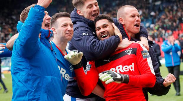 Rangers' goal keeper Wes Foderingham as he celebrates with team mates after the William Hill Scottish Cup semi-final match at Hampden Park