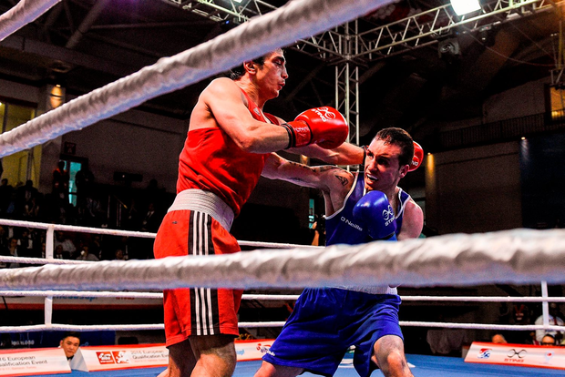 Ireland's David Joyce (blue) exchanges punches with Turkey's Volkan Gokcek during their Men's Lightweight (60kg) box-off bout in the AIBA 2016 European Olympic Qualification tournament in Samsun, Turkey. Pic: Sportsfile