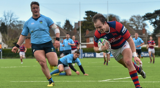 Contarf's Evan Ryan runs in to score his side's first try against UCD. Photo: Cody Glenn / Sportsfile