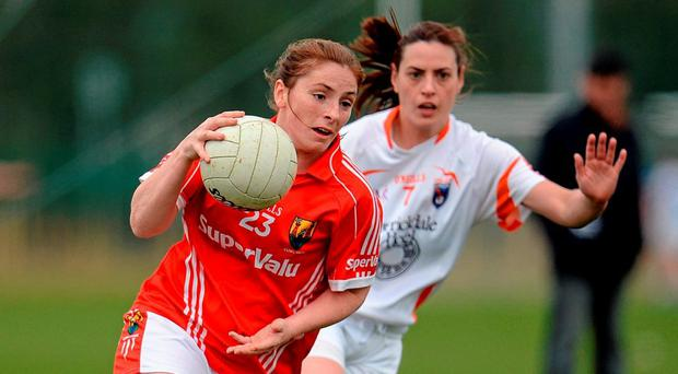 Cork's Rhona Ni Bhuachalla in action against Armagh's Mairead Tennyson. Photo: Seb Daly / Sportsfile