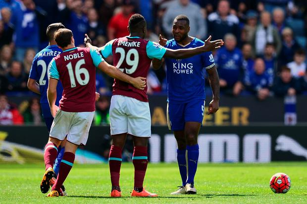 Wes Morgan makes his point to Emmanuel Emenike during Leicester's draw with West Ham yesterday. Photo: Dan Mullan/Getty Images