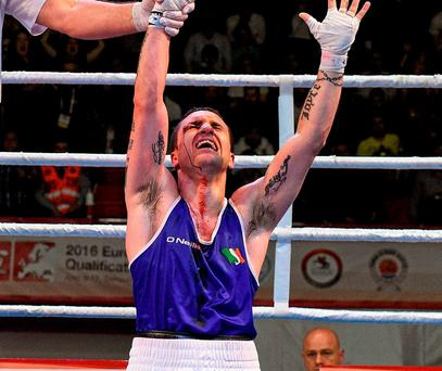 David Oliver Joyce falls to his knees after his victory in yesterday's box-off that secured his place at the Rio Olympics. Photo: Paul Mohan / Sportsfile