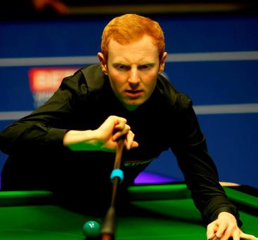 Scotland's Anthony McGill at the table during day two of the Betfred Snooker World Championships at the Crucible Theatre, Sheffield. Photo: Richard Sellers/PA Wire