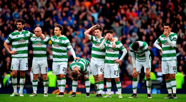 Celtic players react to their penalty shoot-out defeat to Rangers after yesterday's William Hill Scottish Cup semi-final. Photo: Jeff J Mitchell/Getty Images