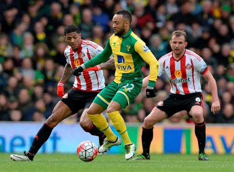 Sunderland's Patrick van Aanholt holds off Norwich's Nathan Redmond. Photo: Alan Walter/Reuters
