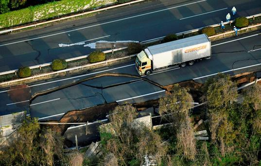 Kyushu Expressway, damaged by an earthquake is seen in Mashiki town, Kumamoto prefecture, southern Japan, in this photo taken by Kyodo April 15, 2016