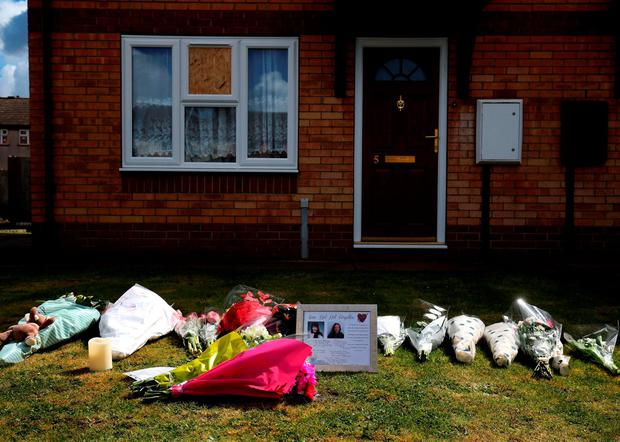 Tributes outside a house in Spalding, Lincolnshire, where a woman and her daughter were found dead as two 14-year-olds have been charged with murder. PRESS ASSOCIATION Photo. Picture date: Sunday April 17, 2016