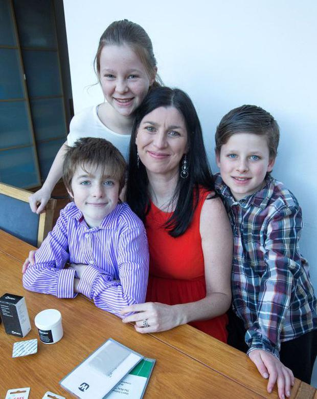 Emma Burthenshaw and her children Alex (11), Matthew (9) and Ciara (13) at their home in Artane.