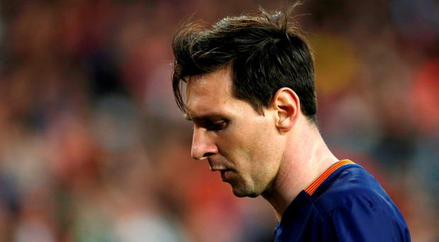 Barcelona's Lionel Messi reacts during the defeat to Valencia. REUTERS/Albert Gea