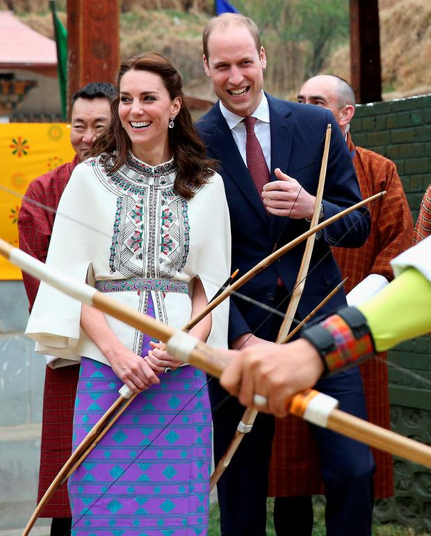 Prince William, Duke of Cambridge fires an arrow as Catherine, Duchess of Cambridge looks on during an Bhutanese archery demonstration on the first day of a two day visit to Bhutan on the 14th April 2016 in Paro, Bhutan. The Royal couple are visiting Bhutan as part of a week long visit to India and Bhutan that has taken in cities such as Mumbai, Delhi, Kaziranga, Bhutan and Agra. (Photo by Chris Jackson/Getty Images)