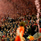 Football Soccer - Liverpool v Borussia Dortmund - UEFA Europa League Quarter Final Second Leg - Anfield, Liverpool, England - 14/4/16 Liverpool fans throw a smoke bomb onto the pitch Action Images via Reuters / Carl Recine
