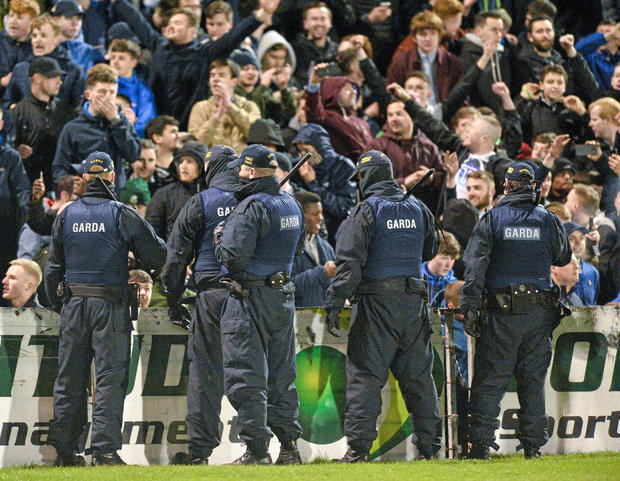 15 April 2016; Members of An Garda Siochana stand in front of Shamrock Rovers supporters. SSE Airtricity League, Premier Division, Bohemians v Shamrock Rovers. Dalymount Park, Dublin. Picture credit: David Maher / SPORTSFILE