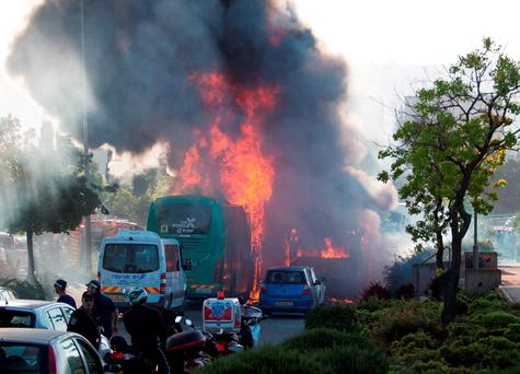 Flames rise at the scene where an explosion tore through a bus in Jerusalem on Monday setting a second bus on fire, in what an Israeli official said was a bombing, April 18, 2016. REUTERS/Noam Revkin Fenton