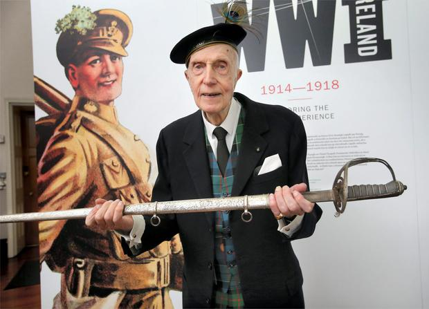 John Leslie with the sword worn by his uncle Norman, who was killed in World War I. Photo: Frank Mc Grath