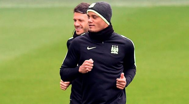 Vincent Kompany is hoping to confirm his availability for next week's clash against Madrid when he returns to action against Newcastle tonight. Photo: Getty