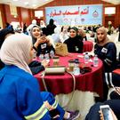 Oil sector employees sit in a hall during an official strike called by the Oil and Petrochemical Industries Workers Union over public sector pay reforms, in Ahmadi, Kuwait