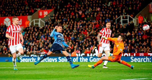 Dele Alli chips the ball past Shay Given for the first of his two goals. Photo: Reuters