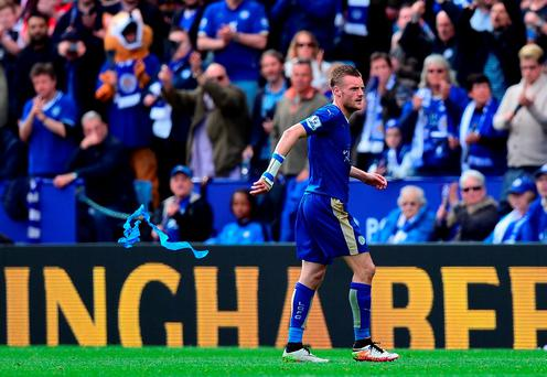 Jamie Vardy of Leicester City walks off after being sent off by referee Jonathan Moss. Photo: Getty